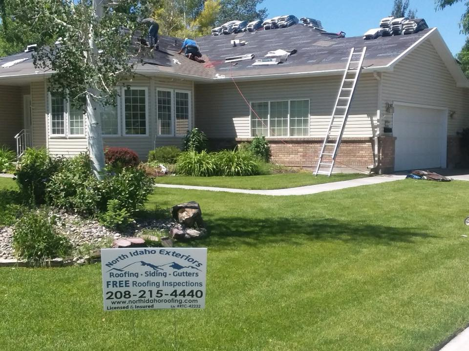 house with a roof getting replaced
